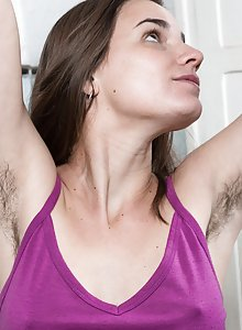 Hippie chick Natalia takes off her cutoff jean shorts to give us views of her very hairy quim