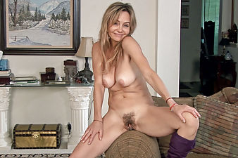 Blonde mature woman shows off her hairy muff