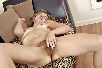 Rachel teases her hairy pussy