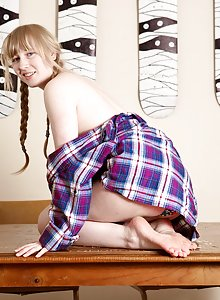 Blonde amateur with pigtails Satine shows how wet her hairy pussy is