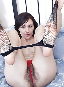 Kristy may be a small breasted brunette, but her real assets are her petite frame and a beautiful hairy pussy.  She loves to get dressed up for her fans, just to strip it off and masturbate.
