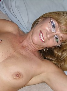 Horny busty MILF wearing glasses Jessica is looking hot in the nude