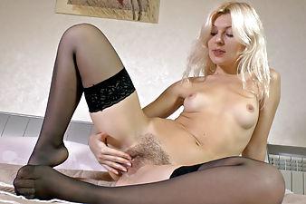 Sexy hairy girl Fedora pleasuring herself on bed