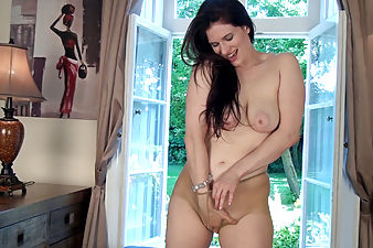 Brianna Green strips by open window