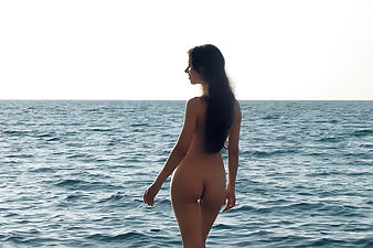 Hairy girl Erika is outdoors at the beach