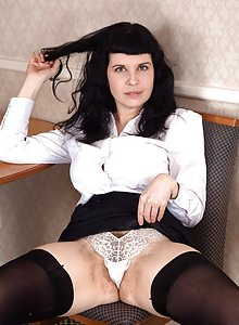 Naughty hairy babe Suzie lets us see her hairy pussy up her skirt
