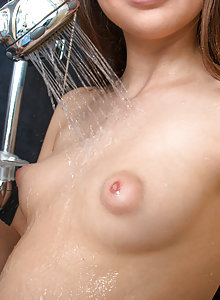 Nubiles Krystyna takes out her puffy nipple natural tits
