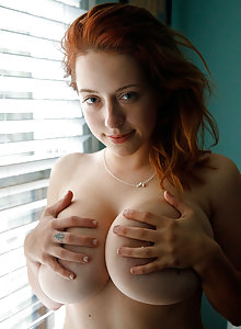 Redhead coed Kelsey Berneray flashing her big titties at the park