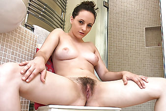 Chloe Lane wakes up hot, bothered and feeling dirty. She takes a steaming hot shower and gently dries her beautiful hairy snatch with a soft towel.