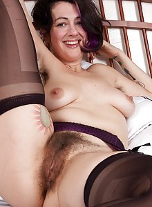 Hairy girl Sadie Lune strips in purple lingerie