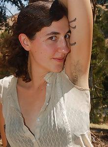 Hairy girl Artemis getting nude outside