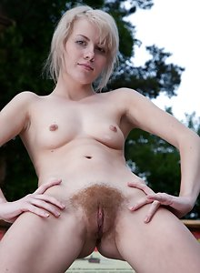 Hairy Nomi gets naked in the sun