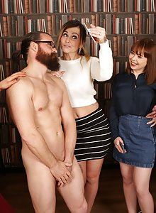 Group of hot library voyeurs keep their clothes on and suck off a lucky guy
