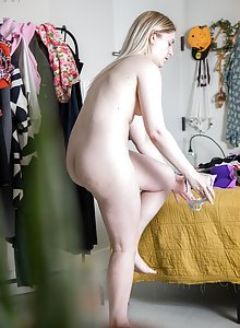 Nude blonde Marilyn D puts her workout clothes on while being filmed in secret