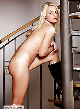 Blonde with small tits Carina gets nude in her boots
