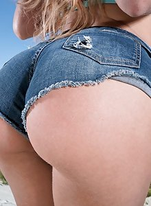 Nasty blonde Cherie DeVille spreads her beautiful ass on the beach
