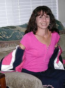 Skinny amateur MILF Sage strips and poses on the couch before spreading her pussy