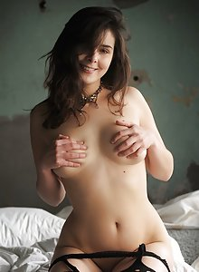 Lovely young babe Amelie Belain showing off in her stockings