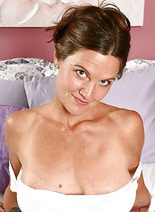 Randy tattooed housewife CJ has nude fun in bed