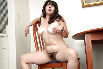 Cleo masturbates hairy pussy during breakfast