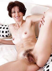 Hairy woman Milady touches her feminine side