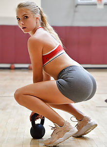 Hot blonde athlete Angelina works out at the gym