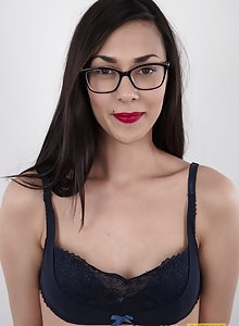 Super skinny amateur Lada wearing glasses but not much else