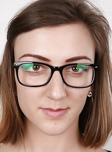 Cute little brunette teeny Vendula wearing glasses as she strips for her casting shots