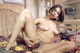 Emilia really pleasures her hairy pussy