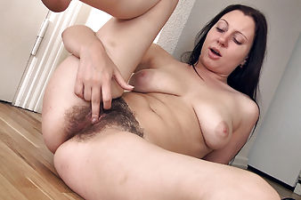 Hairy girl Nancy just got done cleaning her fruit bowl. And now she is so horny that she lays down on the floor and gives her hairy pussy a rubbing that she won't soon forget.