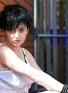 Freckle faced pixie Lucie pulls down her panties outside