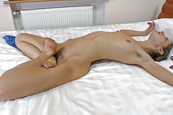 Ryisya does some hairy yoga on the bed
