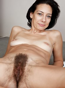 Eva's tone stomach leads down to a hairy patch