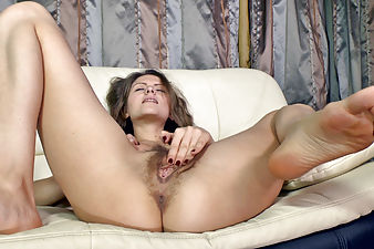 Elena May touches her very hairy pussy