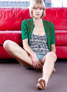 College cutie Michaela pulls her panties aside revealing her natural fur