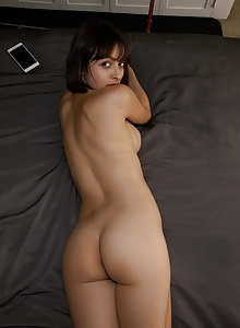 Sultry brunette Basil Navas teases in her apartment
