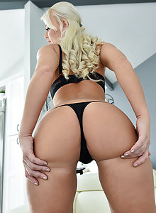 Busty blonde super MILF London in a g-string and nude