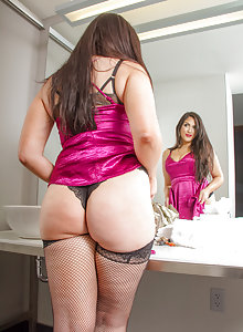 Curvy hottie Milena Shore playing in her stockings in the bedroom