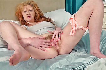 Crystal's hairy pussy gets fingered on the bed