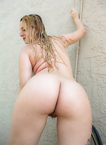 Curvy tattooed blonde with huge melons Layla Moore takes a hot shower outside