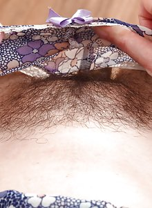 Hirsute secretary Emily Winters strips at her desk and shows her furry cooze