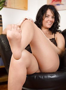 Hot 31 year old MILF Leah H tears off her nylons and plays with her feet