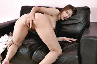 Hairy girl Beata fingers herself on couch