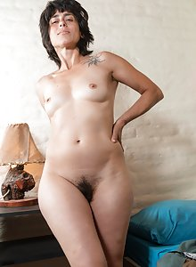 Small breasted hairy amateur Soledad takes off her black dress and undies