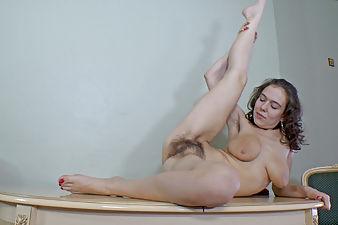 Agneta takes off stockings and panties to play