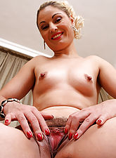 Elegant Ionella struts her mature stuff before opening her beaver